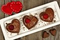 Heart shaped chocolate cups filled with pudding Royalty Free Stock Photo