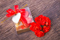 Heart shaped chocolates box with blank card and roses valentine decoration bow decorated red Royalty Free Stock Images