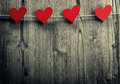 Heart shaped clips are hanging on the rope valentine s day love wallpaper Stock Image