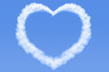 Heart shaped cloud in blue sky Royalty Free Stock Photo