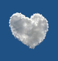 Heart shaped cloud over blue sky Royalty Free Stock Images