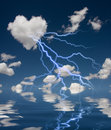 Heart shaped cloud with thunderbolt and reflection on water Royalty Free Stock Images