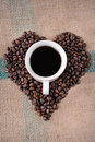 Heart shaped coffee beans Stock Images