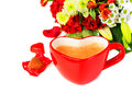 Heart shaped coffee mug of or cappuccino with chocolate and bouquet of red roses studio shot over white background isolated with Royalty Free Stock Photography