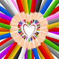 Heart shaped colorful pencils crayons may be suitable for educational projects Stock Photos