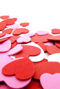 Heart-shaped confetti background Stock Images