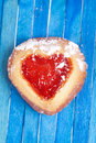 Heart shaped cookie on blue background with strawberry jam Royalty Free Stock Image