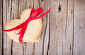 Heart shaped cookie tied with ribbon Stock Images
