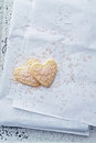 Heart shaped cookies with pink sugar on white paper Royalty Free Stock Photo