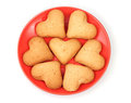Heart-shaped cookies on red saucer Stock Photos