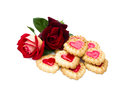 Heart shaped cookies and rose are on a white background Royalty Free Stock Image