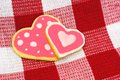 Heart shaped cookies two overlapping homemade on checkered cloth Royalty Free Stock Photo