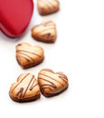 Heart shaped cream cookies on red heart metal box Royalty Free Stock Images
