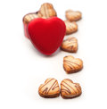Heart shaped cream cookies on red heart metal box Royalty Free Stock Image