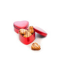 Heart shaped cream cookies on red heart metal box Royalty Free Stock Photo