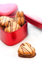 Heart shaped cream cookies on red heart metal box Stock Photos