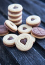 Heart shaped cut out cookies with chocolate filling on the wooden table Royalty Free Stock Photos