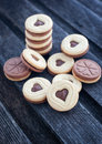Heart shaped cut out cookies with chocolate filling on the wooden table Stock Images