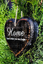 Heart shaped decor sign desk home country style on green plant textured background valentines day card concept Stock Images
