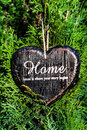 Heart shaped decor sign desk home country style on green plant textured background valentines day card concept Royalty Free Stock Image