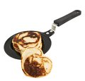 Heart shaped flapjack pancake in a pan Royalty Free Stock Photos