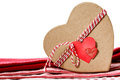 Heart shaped gift box with heart tag on red table cloth Stock Image