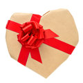 Heart shaped gift a with a red ribbon on a white background Stock Photography