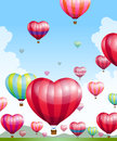 Heart shaped hot air balloons taking off Royalty Free Stock Photo