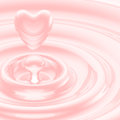 Heart shaped liquid drop in a waves glossy pink Stock Photography