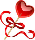 Heart shaped lollipop red with ribbon Stock Image