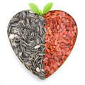 Heart shaped melon & sunflower seeds Royalty Free Stock Image