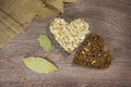 Heart shaped oats and bread on wood background Stock Image