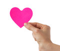 Heart shaped paper note empty in hand Stock Image