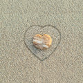 Heart shaped pebble on the beach Royalty Free Stock Photo