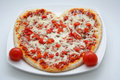 Heart shaped pizza Stock Photo