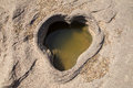 Heart shaped pond on the rock Stock Photography