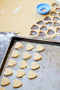 Heart shaped raw cookies on metal baking tray selective focus dough Stock Photos