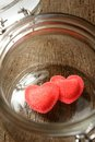 Heart shaped red candies in preserving glass Stock Images