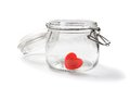 Heart shaped red candies in preserving glass Royalty Free Stock Image