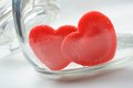 Heart shaped red candies in preserving glass Stock Photo