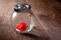 Heart shaped red candies in preserving glass Stock Image