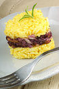 Heart shaped saffron rice with trevisano chicory served on a grey plate idea for a valentine s day dish selective soft focus Royalty Free Stock Images