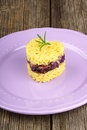 Heart shaped saffron rice with trevisano chicory served on a pink plate over a wooden background idea for a valentine s day dish Royalty Free Stock Image