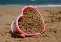 Heart shaped sandcastle bucket childs on the beach Royalty Free Stock Photography