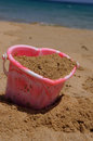 Heart shaped sandcastle bucket portrait childs on the beach Royalty Free Stock Photo