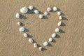 Heart shaped sea shells on the sand beach Royalty Free Stock Photo