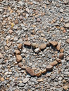 Heart shaped stone on pebble background Royalty Free Stock Photos