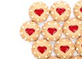 Heart shaped strawberry biscuit on a white background Stock Images