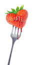 Heart-shaped strawberry on a fork Stock Photo