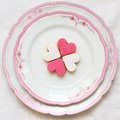 Heart shaped sweet cookies on a beautiful plate decorated with pink rim Royalty Free Stock Image